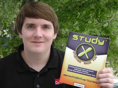 StudyX creator holding a copy of the study software